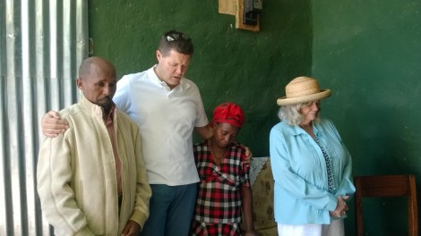 Ann Widdecombe and Peter Waddup pray with a couple in Ethiopia.