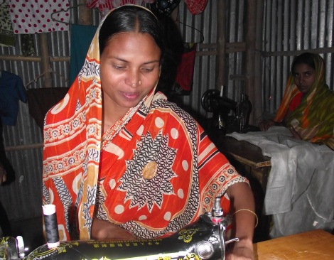 Nasma's husband, Pulmia, is disabled and could not work. She received training to set up her own tailoring business. Pulmia received a prosthetic leg from TLM and is now easily able to help Nasma in their shop. The couple are making a profit and can provide for their children.