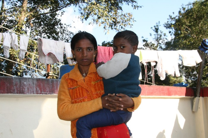 Gita, pictured with one of her sons, during her time as an inpatient at Anandaban Hospital.