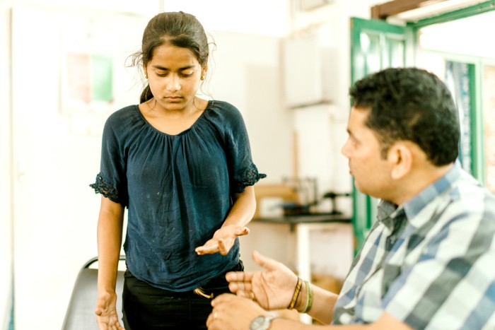 Alina is having physiotherapy to help her regain use of her hands following reconstructive surgery.